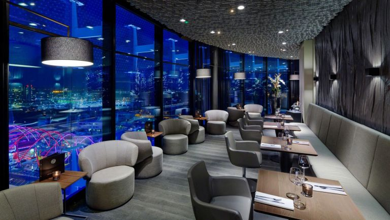The sky bar in Amsterdam's Fletcher hotel, with Rolf Benz sofas, unusual wall finishes and natural grey tones that are carried through into the restaurant design.