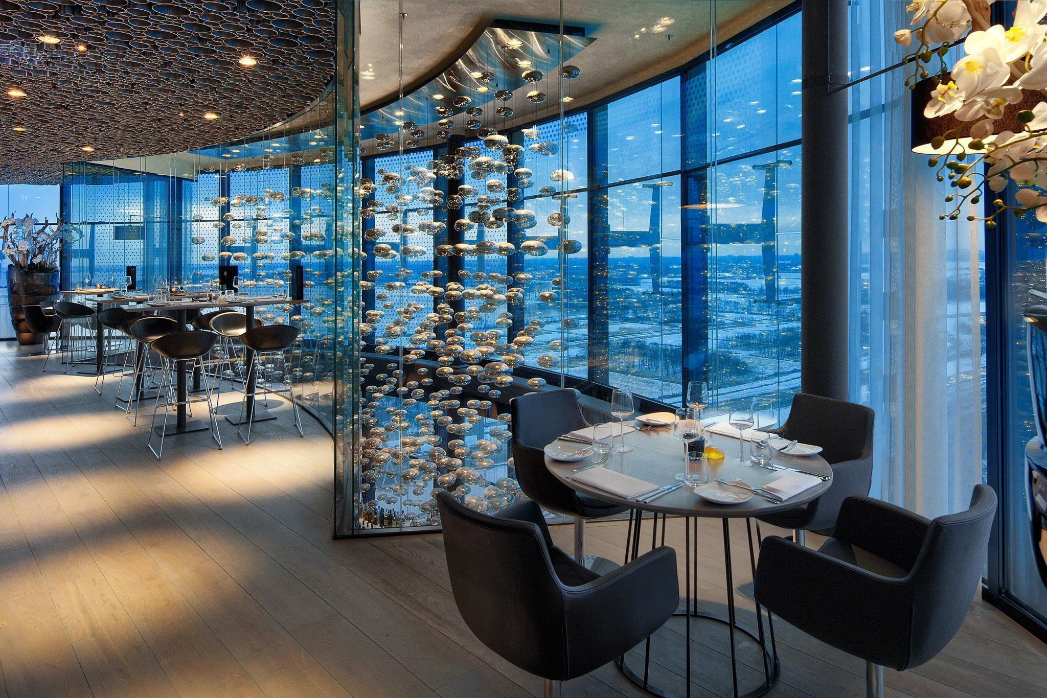 Dream chandelier seen from the luxurious sky restaurant, with a view of the bar below.