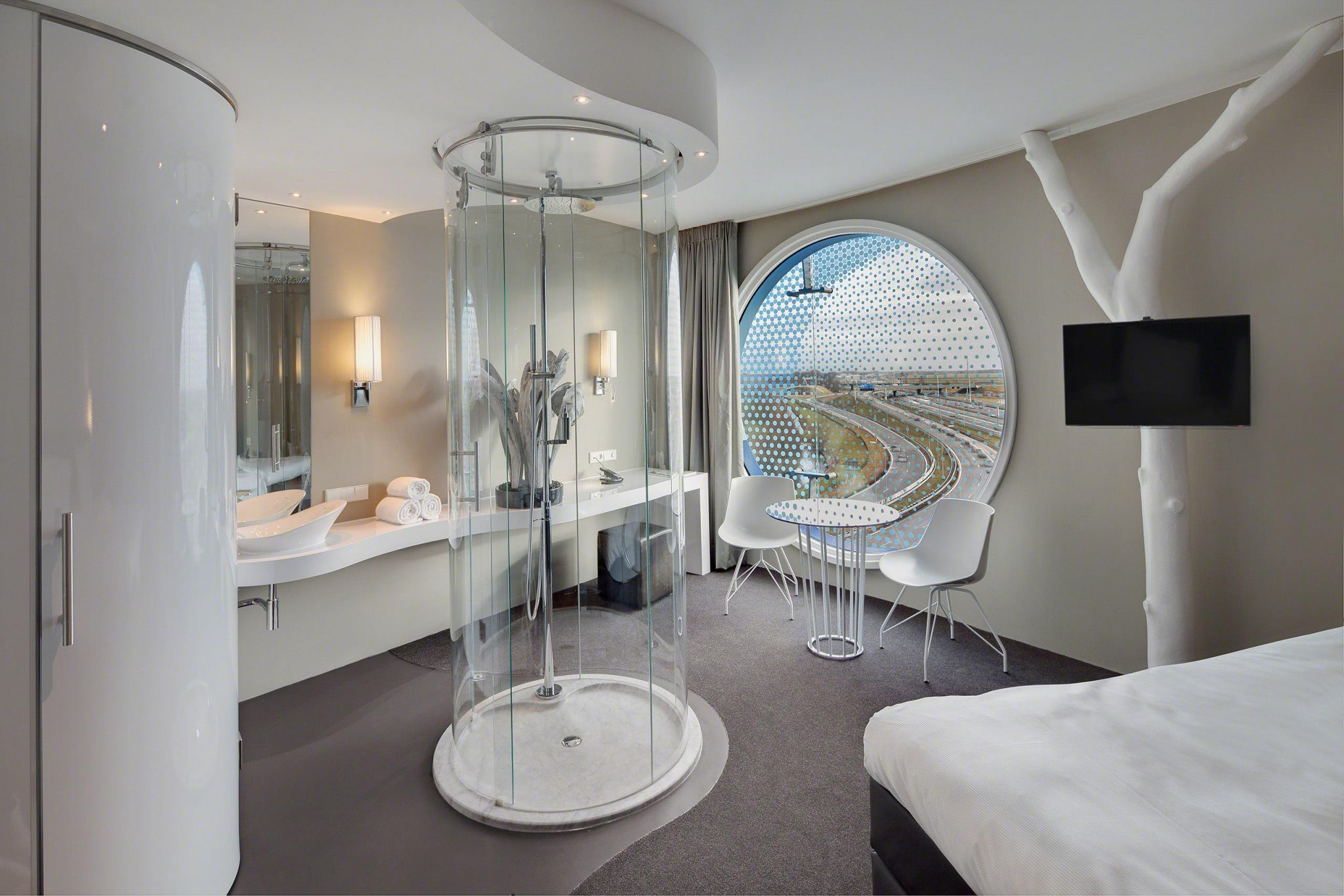 The hotel room design feels like a luxury suite and offers an exclusive bird's-eye view over Amsterdam.