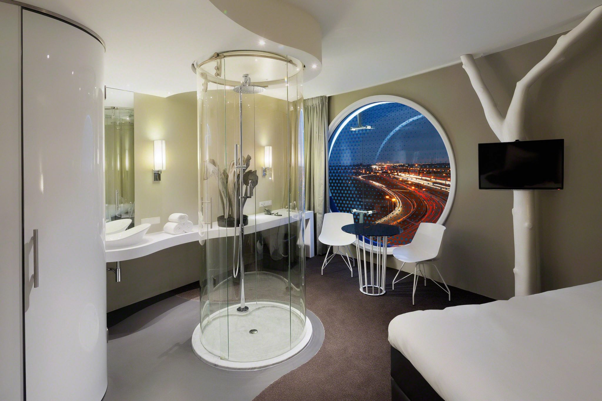 Interior designer Robert Kolenik's hotel room design is inspired by the design hotel's round windows.