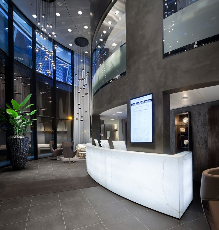 The Fletcher Amsterdam design hotel with its illuminated alabaster reception desk in the hotel lounge.