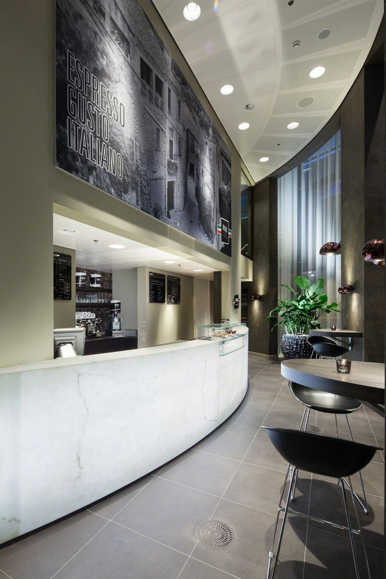 An indirectly-lit alabaster coffee bar gives this hotel design an international feel.