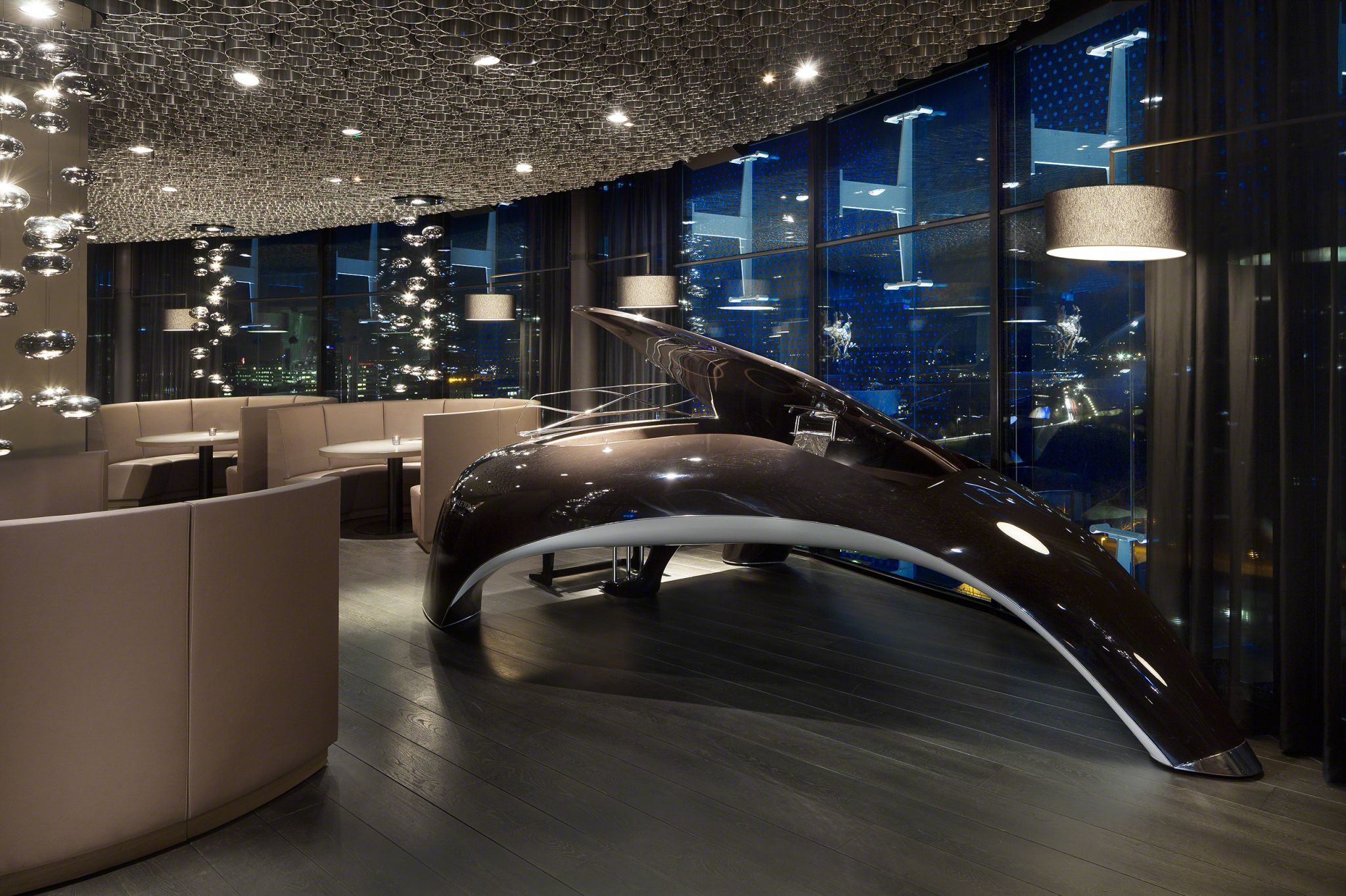 ky bar hospitality design with luxurious chandeliers and round sofas to create an intimate mood.