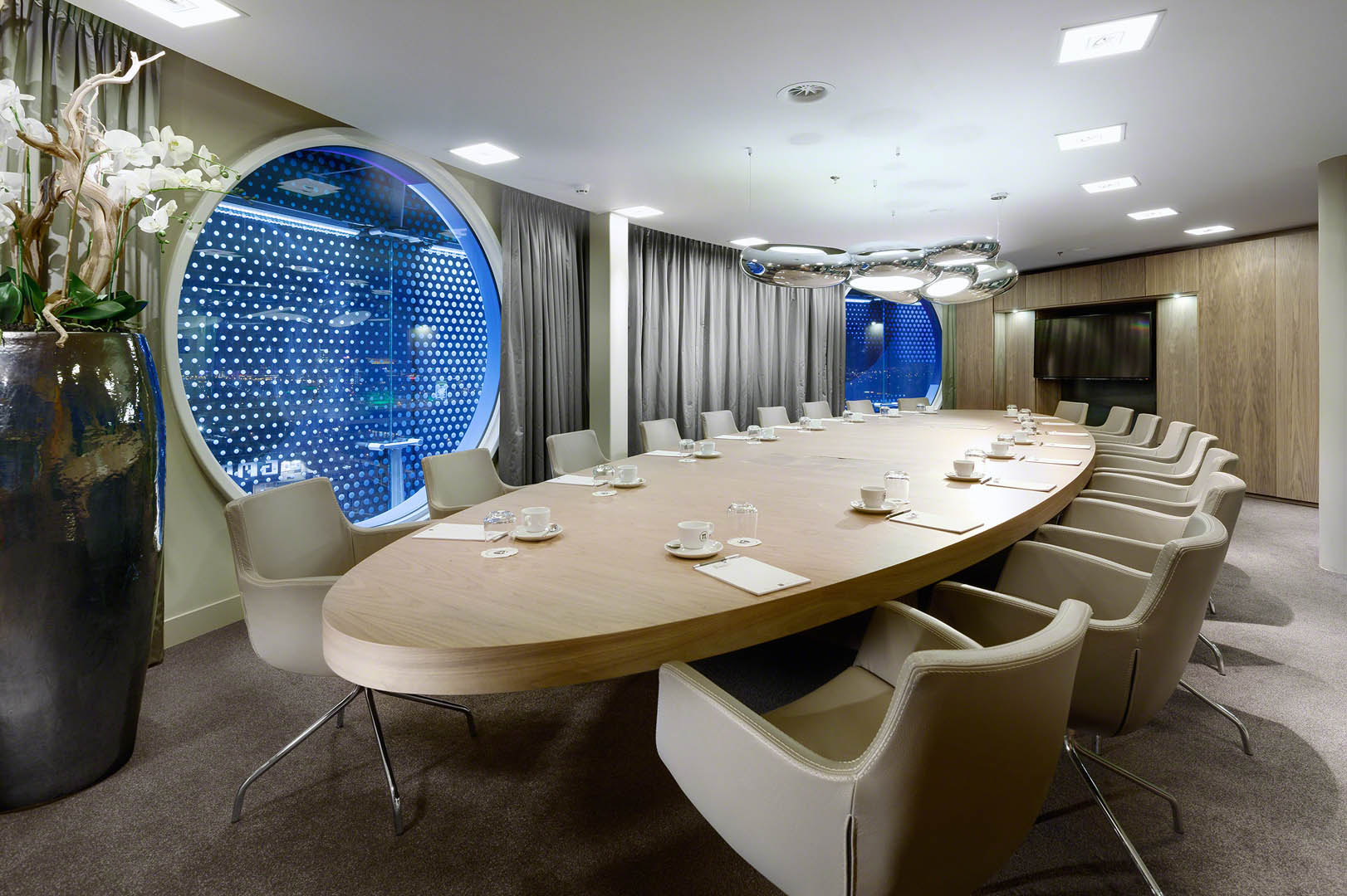 Luxurious boardroom design with an interior whose use of colour and walnut details are inspired by the natural world.