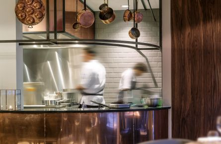 Interior designer Robert Kolenik's open restaurant kitchen with raw soldered seams and taupe coloured metro tiles.